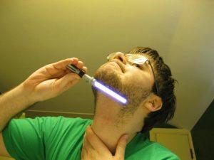 Man Shaving With Lightsaber Funny Laser Image